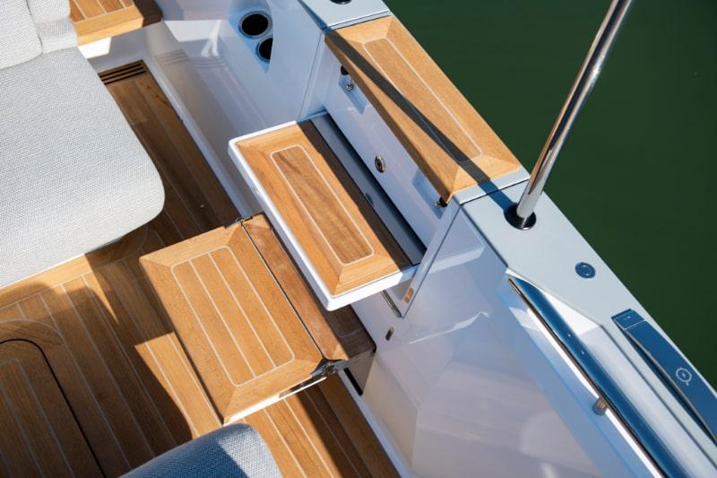 teak steps to board a custom tender
